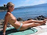 Girlfriend Doing Topless Sunbathing Photo