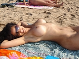 Smiling Milf Shows Amazing Body On Photo Camera At Beach
