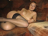 Cute Redhead Posing Naked on the Couch Pictures