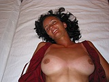 Brunette Wife with a Smile on Camera in Nude Home Pictures