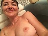 Cute girl with nice rack of big boobs vacation nude photos