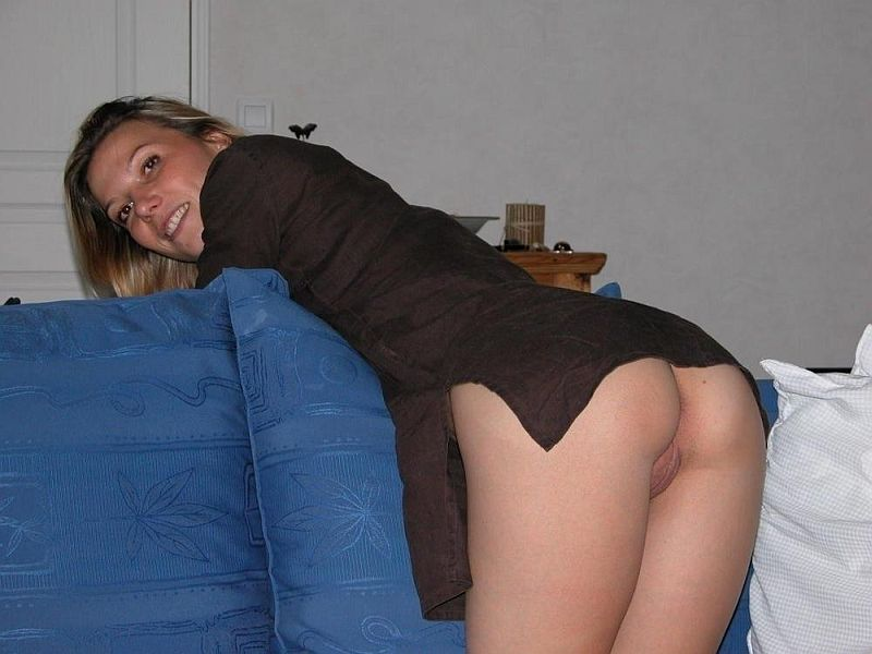 Bending Down Pussy on Couch with a Smile