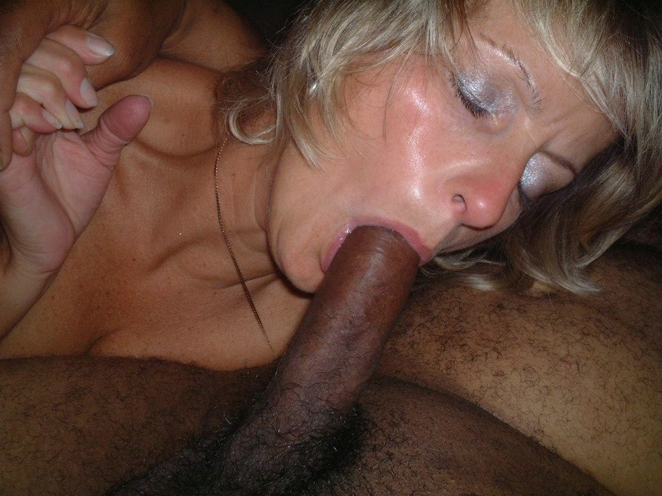 Old milf sucking black cock