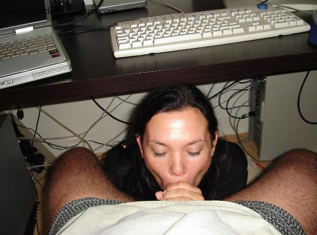 Guys sucking pussy under table just