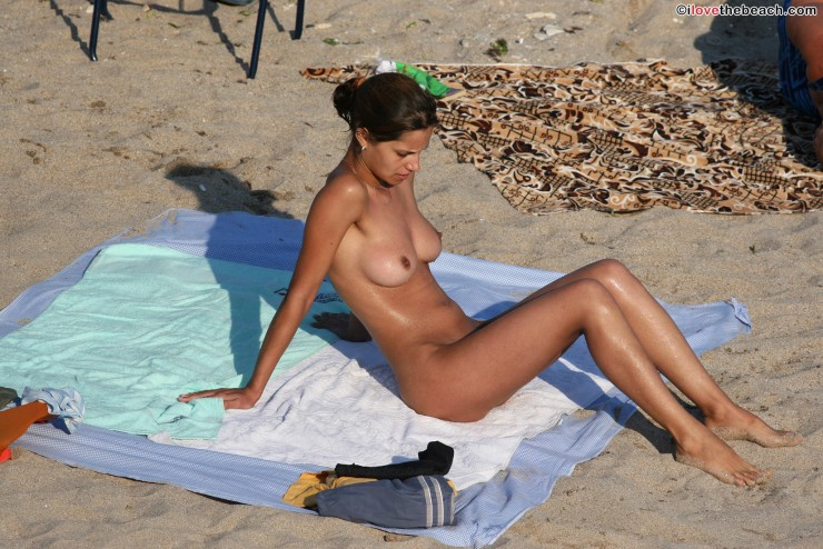 Sunbathing nude women on porn beach