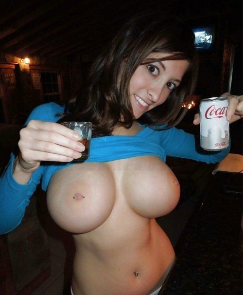 Girlfriend Flashing Big Boobs in Public Pub Photo