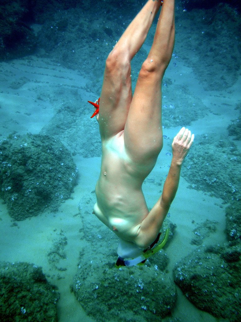Diving nude scuba woman