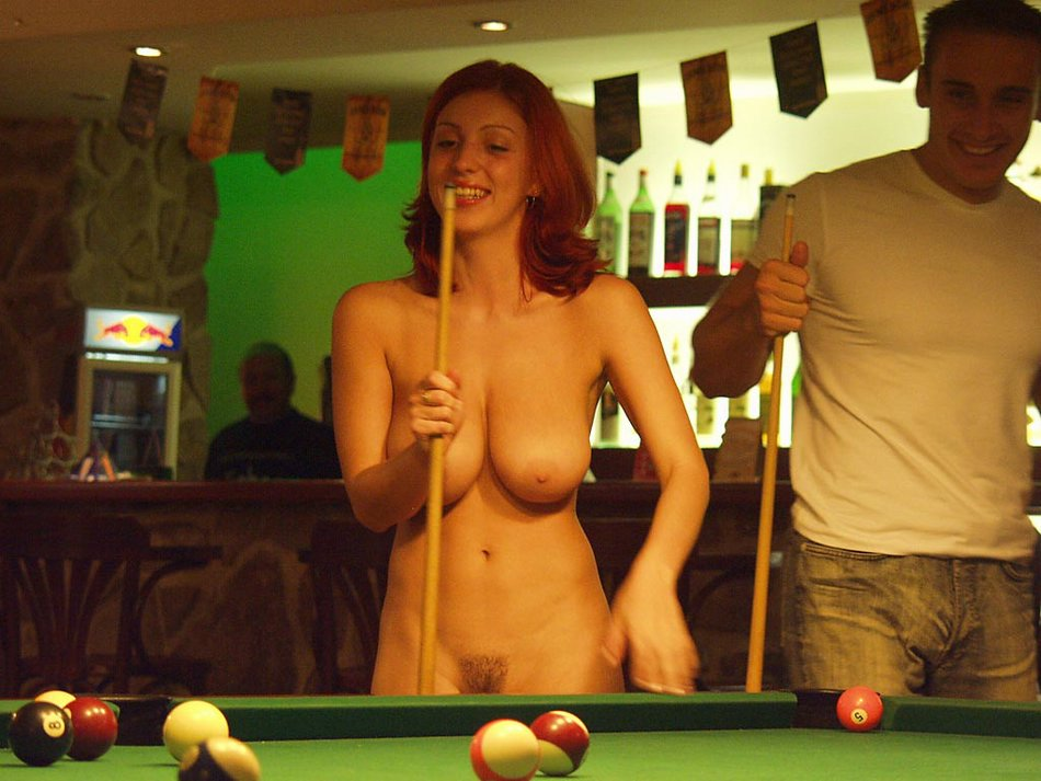 Sexy wife playing pool